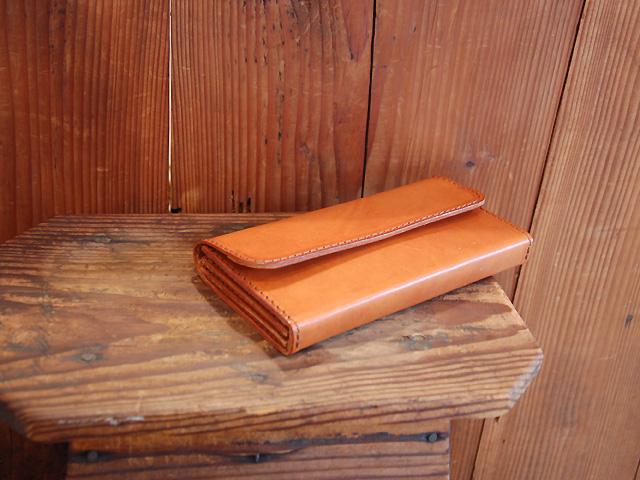クラッチ or 長財布